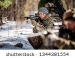 Group of special forces weapons in cold forest. Winter warfare and military concept