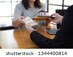 women holding contract and... | Shutterstock . vector #1344400814