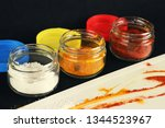 three glass jars with flavoring ... | Shutterstock . vector #1344523967