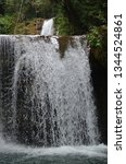 isolated waterfall in tropics | Shutterstock . vector #1344524861