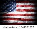closeup of grunge american flag | Shutterstock . vector #1344571757