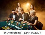 poker players sitting around a... | Shutterstock . vector #1344603374