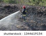 mragowo  poland  grass fire    ... | Shutterstock . vector #1344619154