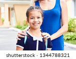 first day at school. mother... | Shutterstock . vector #1344788321