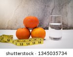 fresh fruit for diet  measuring ... | Shutterstock . vector #1345035734