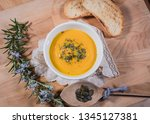 smooth creamy pumpkin soup in a ... | Shutterstock . vector #1345127381