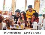 group of asian friends sitting... | Shutterstock . vector #1345147067