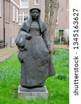 statue of a nun at the... | Shutterstock . vector #1345163627