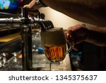 hand of bartender pouring a...   Shutterstock . vector #1345375637