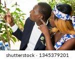 beautiful happy couple sitting... | Shutterstock . vector #1345379201