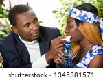 a happy couple in love  a man... | Shutterstock . vector #1345381571