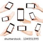 hands holding smart phones...   Shutterstock . vector #134551595