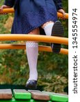 legs of girl in a school... | Shutterstock . vector #1345554974
