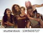 carefree young friends enjoying ... | Shutterstock . vector #1345633727