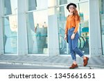 young stylish long haired girl... | Shutterstock . vector #1345661651