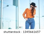 stylish pretty young woman... | Shutterstock . vector #1345661657