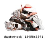 pile of different shoes on... | Shutterstock . vector #1345868591