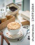 hot almond caramel macchiato. | Shutterstock . vector #1345916864