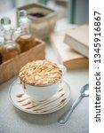 hot almond caramel macchiato. | Shutterstock . vector #1345916867