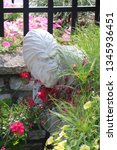 Stock photo bigfoot hiding in the gardens 1345936451