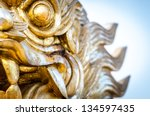 golden stone dragon statue in... | Shutterstock . vector #134597435