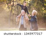 playful with grandparents | Shutterstock . vector #1345977317