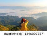 hiker with photo camera... | Shutterstock . vector #1346003387