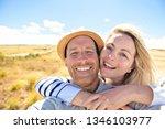 the successful couple mountain...   Shutterstock . vector #1346103977