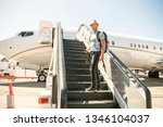 a young traveling man get in...   Shutterstock . vector #1346104037