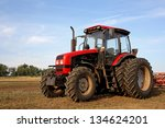Color Photo Of A Red Tractor...