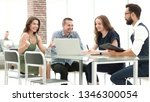 young business team discusses... | Shutterstock . vector #1346300054