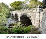 stone road bridge over river in ... | Shutterstock . vector #1346314