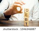 businessman removes wooden... | Shutterstock . vector #1346346887