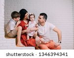 portrait of young happy family... | Shutterstock . vector #1346394341