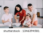 young happy family cooking... | Shutterstock . vector #1346394581