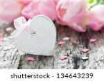 heart shape with bow and copy space - stock photo