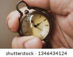 antique watch in hand represent ... | Shutterstock . vector #1346434124