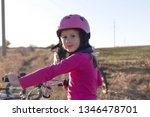 portrait of a little girl in a... | Shutterstock . vector #1346478701