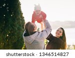 father and mother raise the... | Shutterstock . vector #1346514827