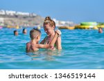 mom and son are playing in the... | Shutterstock . vector #1346519144