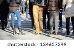 Pedestrians waiting at zebra crossing - stock photo
