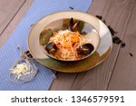 pasta with seafood and grated... | Shutterstock . vector #1346579591