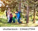family group hiking in woods...   Shutterstock . vector #1346617544