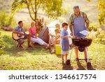 grandson cooking on campfire... | Shutterstock . vector #1346617574