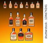 whiskey bottles set  on the... | Shutterstock .eps vector #134674241