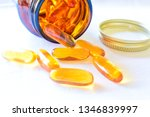 Omega 3 Pills Spreads On The...