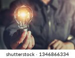 hand holding light bulb. idea... | Shutterstock . vector #1346866334
