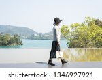 traveling asian woman at the... | Shutterstock . vector #1346927921