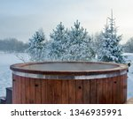 Steaming Wooden Hot Tub With...