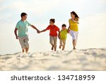 photo of happy family running... | Shutterstock . vector #134718959